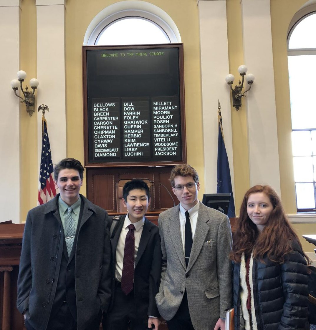 Zach Whiting, Carson Bell, Ben Hall, and Wren Payne in the State Senate Chambers.